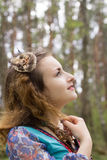 Young female Shaman in the woods. Portrait of a young lady - Female sorcerer Royalty Free Stock Photo