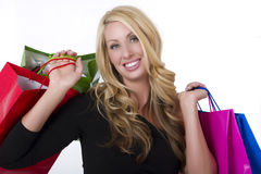 Young Female Shopper. With colorful shopping bags royalty free stock image