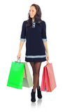 Young female with shopping bags. Smiling young female with shopping bags against a white background Stock Photos