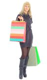 Young female with shopping bags. Smiling young female with shopping bags against a white background Stock Photo
