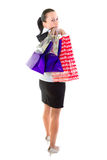 Young female with shopping bags over white Royalty Free Stock Photos