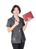 Young female short hair holding up red book Stock Image