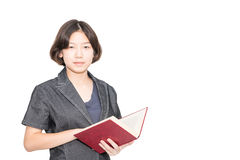 Young female short hair holding up red book Royalty Free Stock Images
