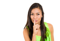 Young female showing hand silence sign Stock Photos