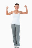 Young female showing her muscles Stock Photo