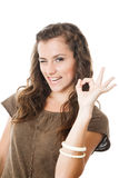 Young female showing ok sign Royalty Free Stock Image