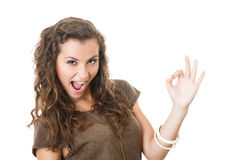 Young female showing ok sign Stock Photos