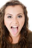 Young female showing tongue Royalty Free Stock Photo