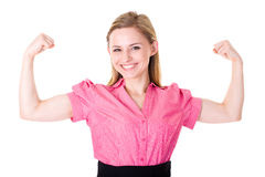Young female shows strength and power, isolated Stock Photo