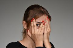 Young Female And Shyness. A young female hispanic teen Royalty Free Stock Photo