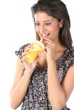 Young female sipping orange juice Stock Photo