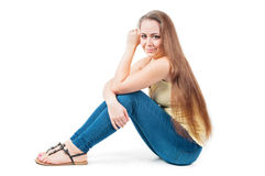 Young female sitting on the floor Stock Photos