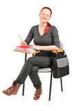 Young female sitting on a school chair Royalty Free Stock Image