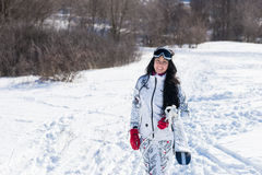 Young Female Skier at the Snow Smiling at Camera Royalty Free Stock Image