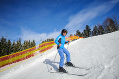 Young female skier on a sunny day at ski resort Royalty Free Stock Images