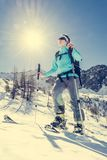 Young female skier. Woman posing on skis Royalty Free Stock Photo