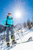Young female skier. Woman posing on skis Stock Image
