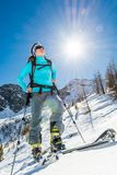 Young female skier. Woman posing on skis Royalty Free Stock Images