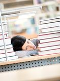 Young female sleeping at the desk Stock Images