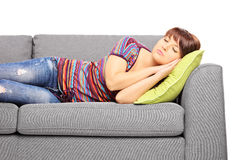 Young female sleeping on a sofa Royalty Free Stock Photo
