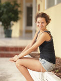 Young female smiling Stock Images