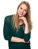 Young female smiling with green sweater Royalty Free Stock Images