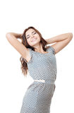 Young female smiling  stretching with eyes closed. Young female with eyes closed  stretching smiling isolated on white Royalty Free Stock Photos