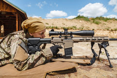 Young female sniper Stock Image