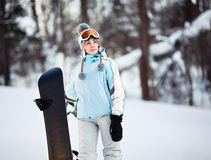 Young female snowboarder Stock Photo