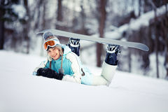 Young female snowboarder resting Royalty Free Stock Image