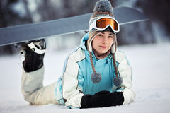 Young female snowboarder resting Royalty Free Stock Photo