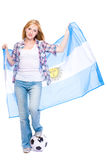 Young female soccer fan, argentina flag and ball Stock Photography