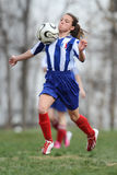 Young female soccer player – chest stop Stock Photography