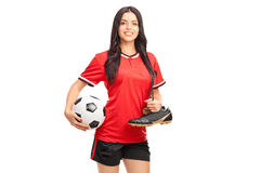 Young female soccer player holding a ball Royalty Free Stock Photos