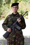 Young female soldier on guard Stock Photo