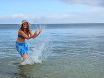 Young female splashing in the water Stock Photography