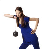 Young female with sport hammer looking ahead. Young female posing with sport hammer in hand Royalty Free Stock Photo