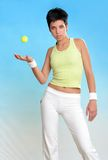 Young female in sport wear. Beautiful female in sport wear with tennis ball Stock Photography