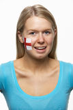 Young Female Sports Fan With England Flag On Face royalty free stock images