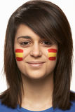 Young Female Sports Fan With Spanish Flag Painted Royalty Free Stock Photography
