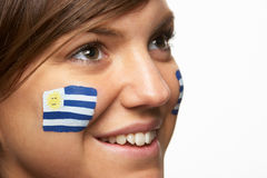 Young Female Sports Fan With Uruguayan Flag Painte Royalty Free Stock Photo