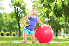 Young female in sportswear resting in park Royalty Free Stock Image