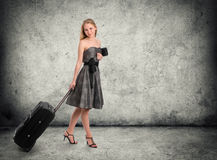Young female standing with her travel bag Stock Photography