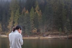Young female is standing by the water and crying stock photo