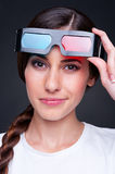 Young female with stereo glasses. Over dark background Royalty Free Stock Images