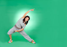 Young female in stretching over green Royalty Free Stock Images