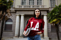 Young female student with Asia stands on the background of the university Stock Photo