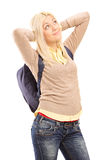 Young female student with backpack daydreaming Stock Photos