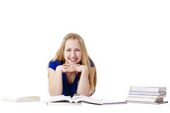 Young female student with books at floor Royalty Free Stock Photos