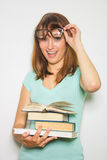 Young female student with books on white. Stock Photo